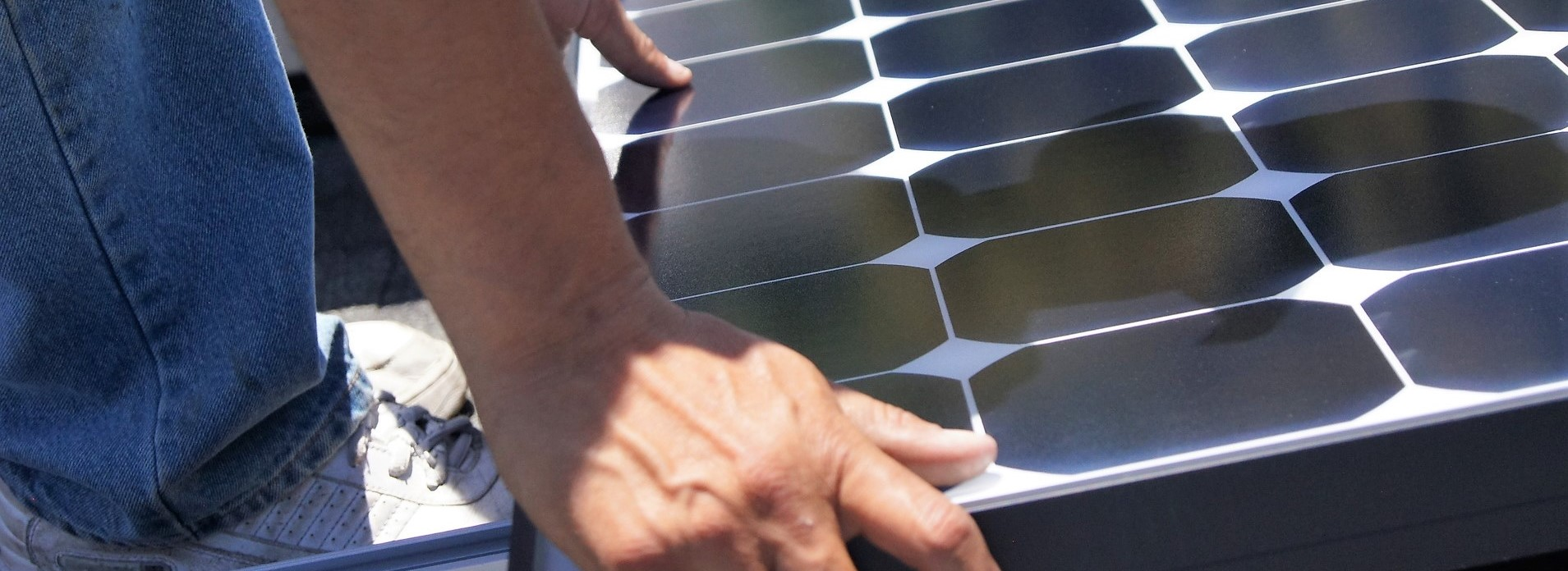 solar panel workers hand